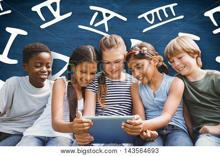 Children using digital tablet at park against blue chalkboard