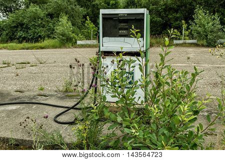 Old Gas Station Overgrown With Bushes