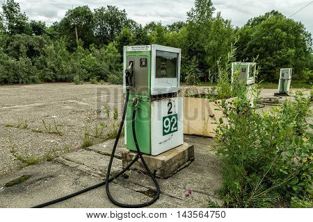 Old Gas Station Pump Overgrown With Bushes