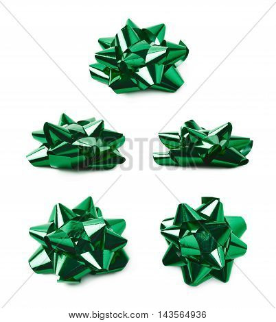 Decorational bow made of glossy green tape, composition isolated over the white background, set of five different foreshortenings