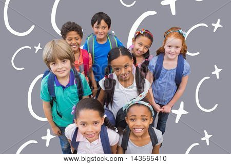 Smiling pupils in classroom against grey background