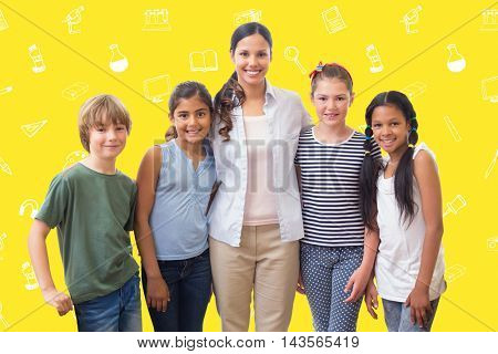 Cute pupils and teacher smiling at camera in computer class against yellow background