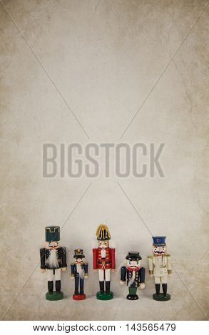 Old wooden vintage background with a collection of nutcruckers.