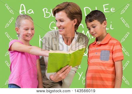 Teacher reading book with pupils at library against green background