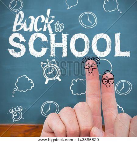 Hand of businessman in suit gesturing against blackboard