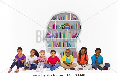 Elementary pupils reading books against colorful books arranged in human face shape bookshelves