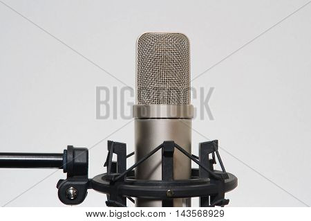 Professional condenser microphone in a studio environment