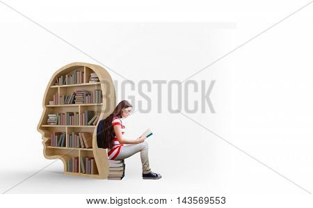 Student reading book in library against books in brown human face bookshelves