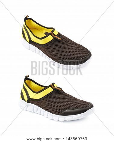 Light running sport shoes, colored yellow and black, isolated over the white background, set of two different foreshortenings