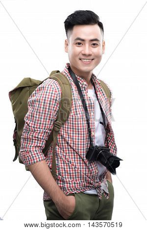 Travel concept. Studio portrait of handsome young man in hat with backpack. Isolated on white.