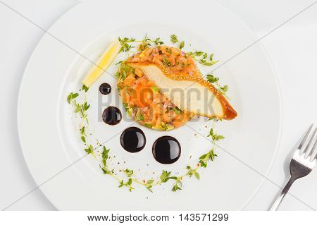 Top view on Salmon with Avocado Tartare with Lemon.