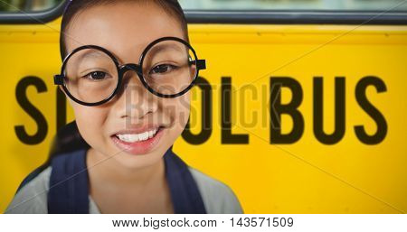 Close-up of young smiling against school bus