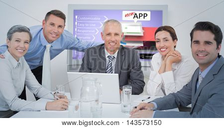 Business team looking at camera against computer graphic image of mobile application concepts