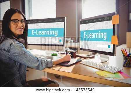 E-learning interface against businesswoman smiling while working at office