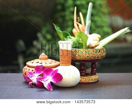 Natural Spa Ingredients herbal compress ball and herbal Ingredients for alternative medicine and relaxation Thai Spa theme with silk fabric