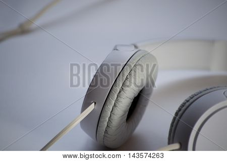 White and big headphones on white background