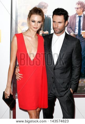 NEW YORK-JUNE 25: Behati Prinsloo (L) and Adam Levine attend the New York premiere of