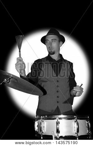 Drummer holding drum brushes. Black and white photography