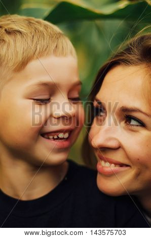 Portrait Of A Happy Mother And Her Son  Outdoor.  Series Of A Mo