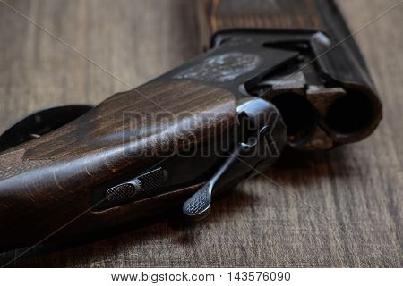 Old hunting rifle on a wooden background