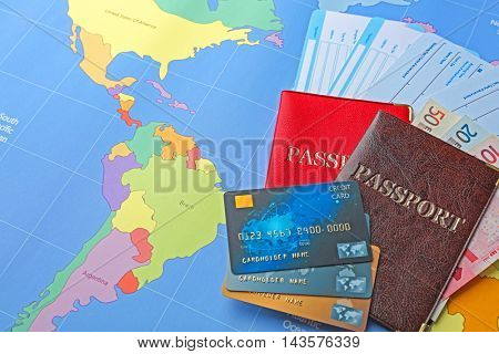 Credit cards and tickets on world map background