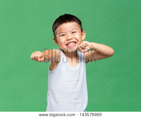 Little boy doing Kung Fu gesture