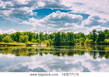River Landscape With Reflections Of Clouds And Woods In Water. Summer. Sunny Day. Nobody