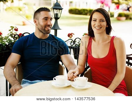 Young couple is ejoying coffee early in the morning.