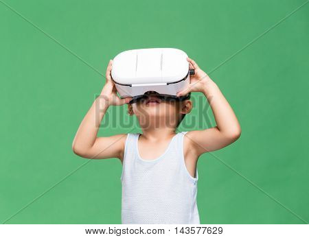 Asian little boy watching though Virtual reality