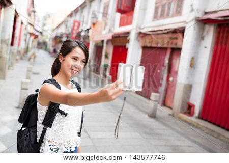 Young Woman taking selfie by digital camera