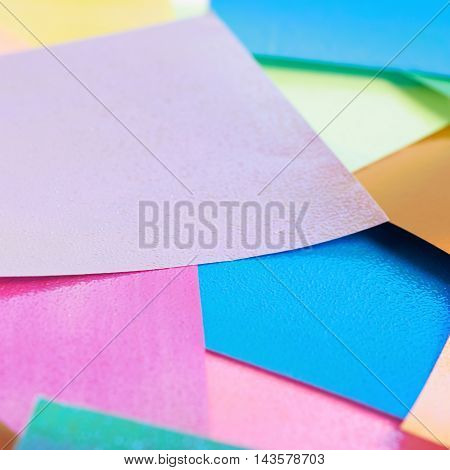 Surface coated with the multiple colorful origami paper sheets as an abstract background composition
