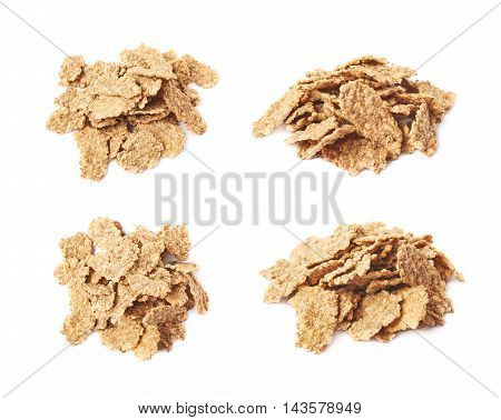 Pile of wholegrain cereal flakes isolated over the white background, set of four different foreshortenings