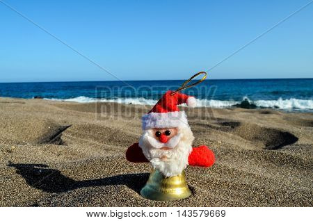 Santa Claus Toy On The Sand Beach