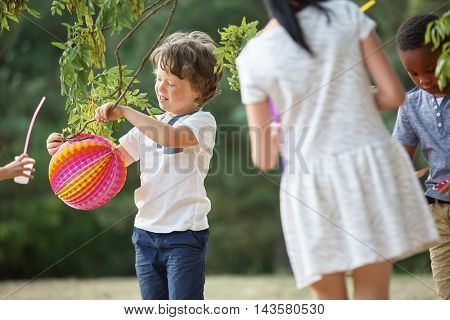 Group of kids at party having fun with lampions