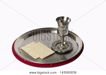White cup on a tray lighten with lamp from a door
