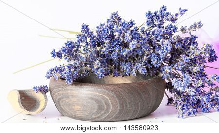 Bunch of dry wild mountain lavender flowers and wooden bowl