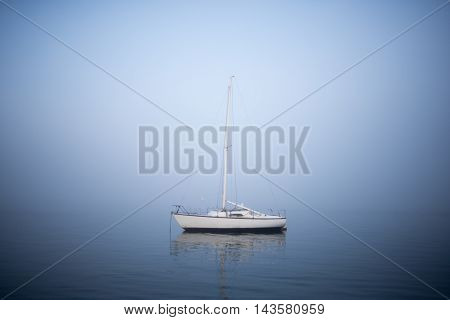 Sailing Boat In The Mist