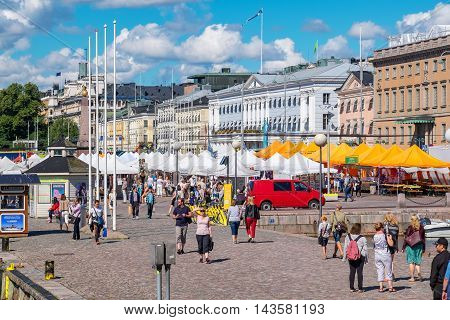 HELSINKI FINLAND - JULY 19 2016: Tourists visiting and shopping at Market Square near Helsinki Northern Harbour