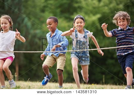 Interracial group of kids at the finish line