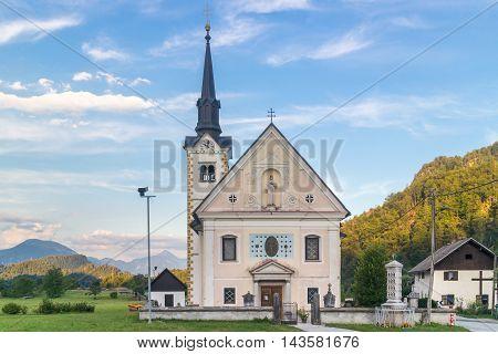 Traditional catholic church in Bohinjska bela village, near Bled, Slovenia.