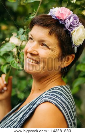 A Portrait Of A Middle Age Woman. Portrait Of A Beautiful Woman 55 Years Old Posing On The Rim Of Th
