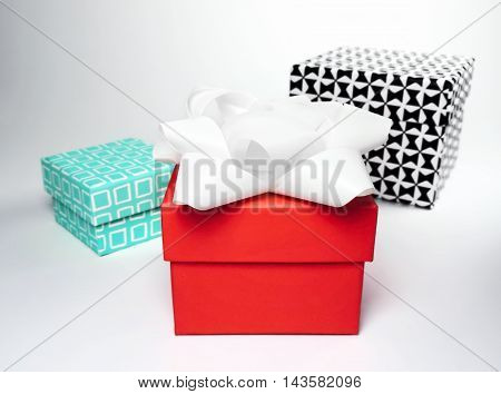 Various design gift boxes with bow. Birthday or christmas presents, studio shot on white background.