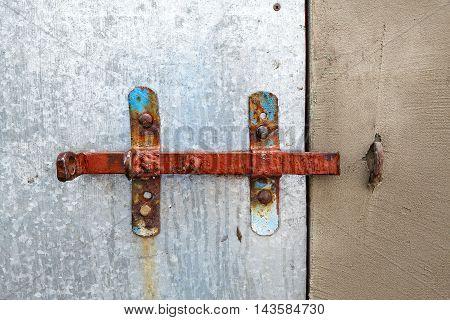 old rusty sliding lock on the door
