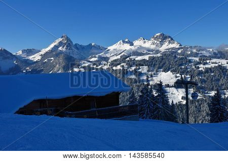 Snow covered mountains in Gstaad. Mt Videmanette. View from the middle station of the Wispile ski area Switzerland.