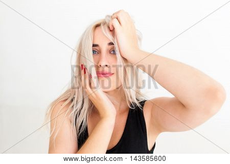 Portrait of blonde woman making difficult choice. Young attractive woman thinking about something important and panicking. Human facial expression emotions, feelings, body language