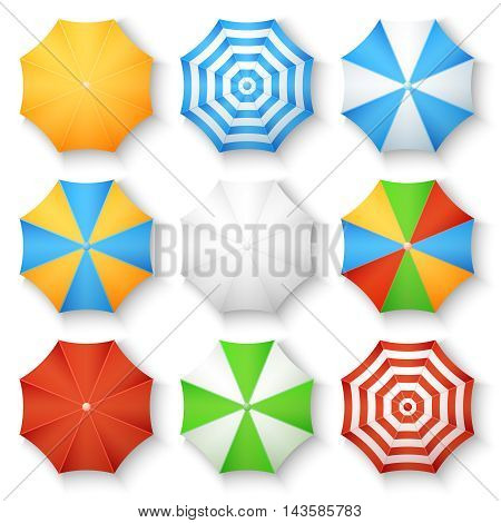 Beach sun umbrellas top view vector icons. Set of parasol with colored striped pattern illustration