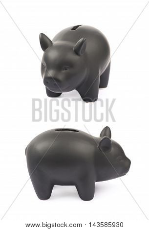 Black ceramic piggy bank coin container isolated over the white background, set of two different foreshortenings
