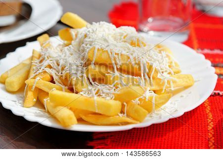Typical Bulgarian fried potatoes sprinkled with grated white cheese.