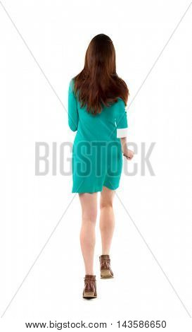 back view of running  woman. beautiful girl in motion. backside view of person.  Rear view people collection. Isolated over white background. Long-haired brunette in a green dress runs away into the