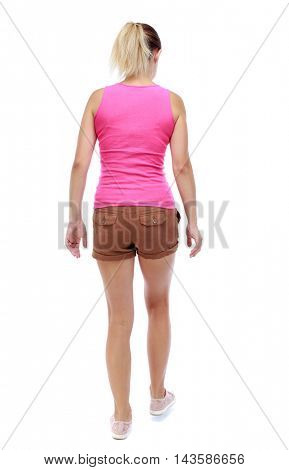 back view of walking  woman. beautiful blonde girl in motion.  backside view of person.  Rear view people collection. Isolated over white background. Sport blond in brown shorts takes a step forward.